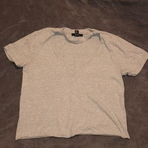 Gray t shirt with triangular cut at the top